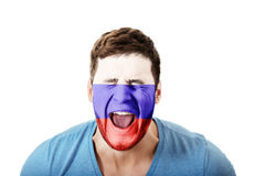 Screaming man with Russia flag on face. Royalty Free Stock Photo