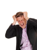 Screaming man scratching his head. Stock Images