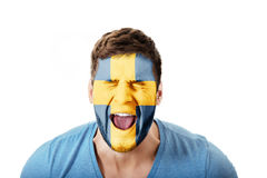 Screaming man with Sweden flag on face. Royalty Free Stock Photos