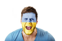 Screaming man with Ukraine flag on face. Royalty Free Stock Photography