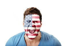 Screaming man with USA flag on face. Royalty Free Stock Image