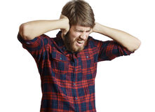 Screaming man. Screaming young man in the plaid shirt close his ears because too loud, isolated on a white background Royalty Free Stock Image