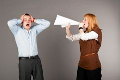Screaming with megafon. Business women is screaming to her associate with megaphone Royalty Free Stock Photos