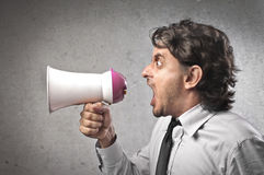 Screaming into a Megaphone Stock Image