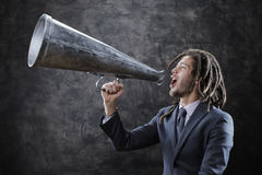 Screaming into megaphone Royalty Free Stock Photography