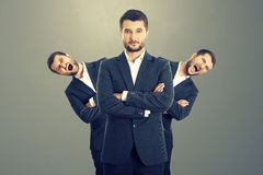 Screaming men behind confident businessman Royalty Free Stock Photos