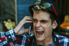 Screaming on the mobile Stock Image
