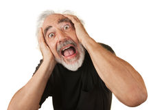 Screaming Older Man. Screaming man covering his ears over white background Stock Images
