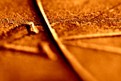 Screaming Orange Sundial Texture 1. Abstract texture of sundial. Orange. Close-up and blurred. Thin band of focus royalty free stock photo