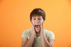 Screaming Out Loud. Young Caucasian girl scared and screaming her lungs out Royalty Free Stock Photography