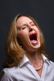 Screaming in pain stock photo