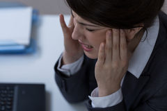 Screaming in pain. Young attractive businesswoman screaming in headache Stock Images