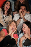 Screaming People. Scared group of spectators in theater seats scream in fear Stock Image