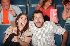 Screaming People. Group of people in audience react in fear Stock Photos