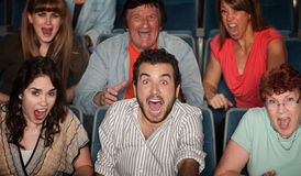 Screaming People. Group of scared people screaming in their seats Royalty Free Stock Photo