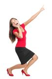 Screaming and pointing woman. Funny full length image of a beautiful mixed race caucasian / chinese young woman model dressed casual in red. Isolated on white Stock Image