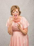 Screaming Pregnant Lady. Single pregnant person in pink dress screaming Stock Images