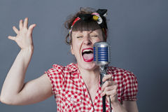 Screaming 30s female rocker and vocal artist with retro style Stock Photo