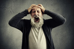 Screaming senior man with closed eyes Stock Image