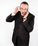 Screaming serious man with glasses and phone Royalty Free Stock Photography