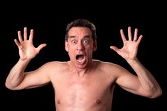 Screaming Shirtless Man on Black Stock Photos