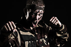 Screaming soldier wants to fight with enemy. Screaming soldier want's to fight with enemy. studio shot over black background stock photo