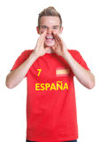 Screaming spanish sports fan with blond hair Royalty Free Stock Photos