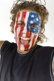 Screaming sports fan. Young screaming fan with painted The USA flag on face. He's looking at camera. Front view Stock Images