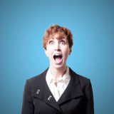 Screaming success short hair business woman. On blue background Stock Images