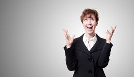 Screaming success short hair business woman. On gray background Stock Photography