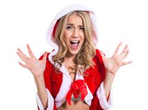 Screaming surprised beautyful woman in red santa claus clothes Stock Photos