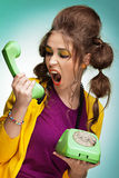 Screaming on the telephone. Young woman screaming on the phone Stock Photography