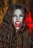 Screaming vampire. Screaming halloween beautiful vampire with long hair Stock Images