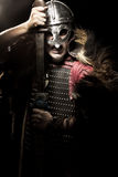 Screaming viking warrior with sword, armour and helmet over blac Royalty Free Stock Photos