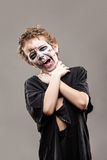 Screaming walking dead zombie child boy Royalty Free Stock Image