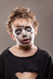 Screaming walking dead zombie child boy. Halloween or horror concept - screaming walking dead zombie child boy reaching hand Royalty Free Stock Images