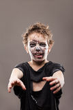Screaming walking dead zombie child boy Stock Images