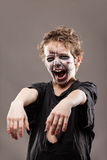 Screaming walking dead zombie child boy Stock Photo