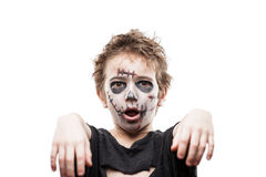 Screaming walking dead zombie child boy halloween horror costume. Halloween or horror concept - screaming walking dead zombie child boy reaching hand white Royalty Free Stock Photos