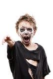 Screaming walking dead zombie child boy halloween horror costume. Halloween or horror concept - screaming walking dead zombie child boy reaching hand white Stock Photo