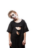 Screaming walking dead zombie child boy halloween horror costume. Halloween or horror concept - screaming walking dead zombie child boy reaching hand white Royalty Free Stock Images