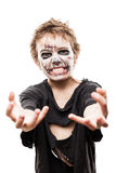 Screaming walking dead zombie child boy halloween horror costume. Halloween or horror concept - screaming walking dead zombie child boy reaching hand white Stock Photography