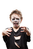 Screaming walking dead zombie child boy halloween horror costume. Halloween or horror concept - screaming walking dead zombie child boy reaching hand white Royalty Free Stock Image