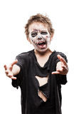 Screaming walking dead zombie child boy halloween horror costume. Halloween or horror concept - screaming walking dead zombie child boy reaching hand white Royalty Free Stock Photo