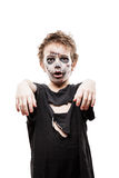 Screaming walking dead zombie child boy halloween horror costume. Halloween or horror concept - screaming walking dead zombie child boy reaching hand white Royalty Free Stock Photography