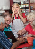 Screaming Watiress and Arguing Seniors Stock Image