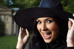 Screaming witch in hat Stock Images