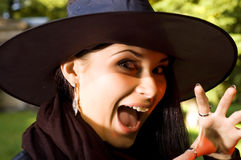 Screaming witch in hat Stock Photography