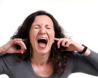 Screaming woman. On a white background Royalty Free Stock Photography