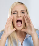 Screaming woman. Screaming blonde woman on white background Royalty Free Stock Images